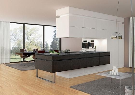 Gebruik de keuken als afscheiding tussen het woongedeelte ...